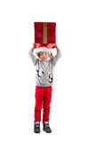 Child holding his christmas present Stock Photography