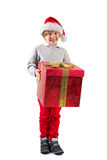 Child holding his christmas present Stock Photos