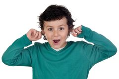Child holding his hands against his ears Royalty Free Stock Photos