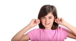 Child holding his hands against his ears Royalty Free Stock Image