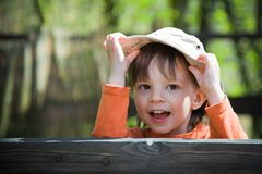 Child holding his hat Stock Photography