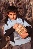 A child  holding his peanuts Stock Photos
