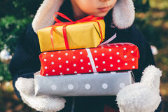 Child holding holiday gifts Stock Photography