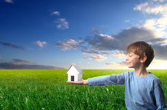 Child holding a house Royalty Free Stock Photos