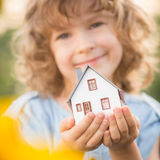 Child holding house in hands Royalty Free Stock Photography