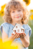 Child holding house in hands Stock Images