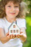 Child holding house Royalty Free Stock Photo