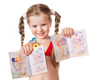Child holding international passport. Little girl holding international passport. Isolated Royalty Free Stock Images