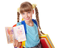 Child holding international passport and book. Little girl holding international passport and book. Foreign vacation Royalty Free Stock Photo