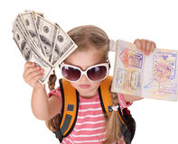Child holding international passport and money. Royalty Free Stock Photos