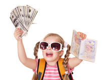 Child holding international passport and money. Little girl holding international passport and money. Foreign vacation Stock Photography