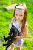 Child holding kitten Royalty Free Stock Images