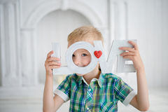 The child holding the letter LOVE and smiling Royalty Free Stock Image