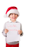Child holding a letter to santa Stock Photo