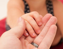 Child Holding Mans Hand Royalty Free Stock Photography