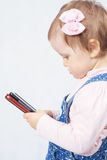 Child holding a mobile phone Royalty Free Stock Photo