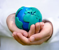 Child holding model of Earth Royalty Free Stock Photo