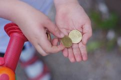 Child holding money hands. A child holding money in the hands Royalty Free Stock Images