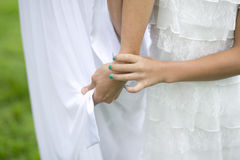 Child Holding Mother's hand. At Outside Wedding with Painted Nails Royalty Free Stock Image