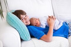 Child holding newborn sibling Stock Image