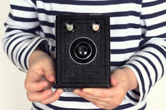Child with old camera. Child holding an old camera Royalty Free Stock Images