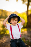 Child holding onto hat Stock Photos