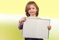 Child holding a open book Royalty Free Stock Photography