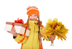 Child holding orange leaves and gift box. Stock Photos
