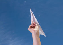 Child holding a paper airplane Royalty Free Stock Image