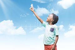 Composite image of child holding paper airplane. Child holding paper airplane against blue sky stock image