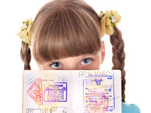Child holding  passport. Royalty Free Stock Photo