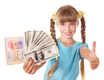 Child holding  passport and money. Royalty Free Stock Photography