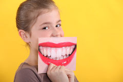 Child holding picture of mouth Stock Images