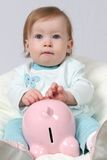 Child Holding Piggy Bank Stock Image