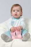 Child Holding Piggy Bank Stock Images