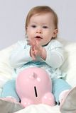 Child Holding Piggy Bank and C Stock Images
