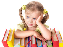 Child holding pile of books. Royalty Free Stock Image