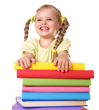 Child holding pile of books. Royalty Free Stock Photo