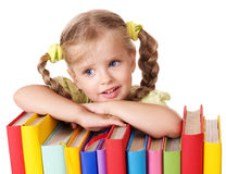 Child holding pile of books. Royalty Free Stock Images