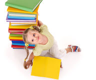 Child holding pile of books. Stock Image