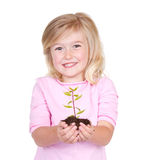 Child holding a plant Stock Photo