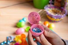 Child holding plastic easter egg stock photos