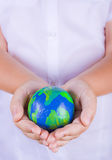 Child holding plasticine globe in hands Stock Photography