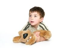 Child holding a plush toy Stock Image
