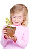 Child holding a potted plant Royalty Free Stock Images