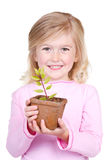 Child holding a potted plant Stock Images
