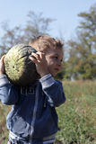 Child holding pumpkin Stock Photography