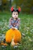 Child holding pumpkin. Halloween concept Royalty Free Stock Photos