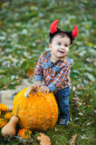 Child holding pumpkin. Halloween concept Royalty Free Stock Photography