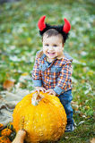 Child holding pumpkin. Halloween concept Royalty Free Stock Image